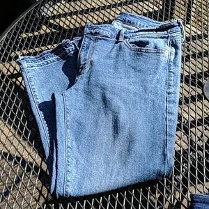 Gap Girlfriend raw edge ankle jeans.
